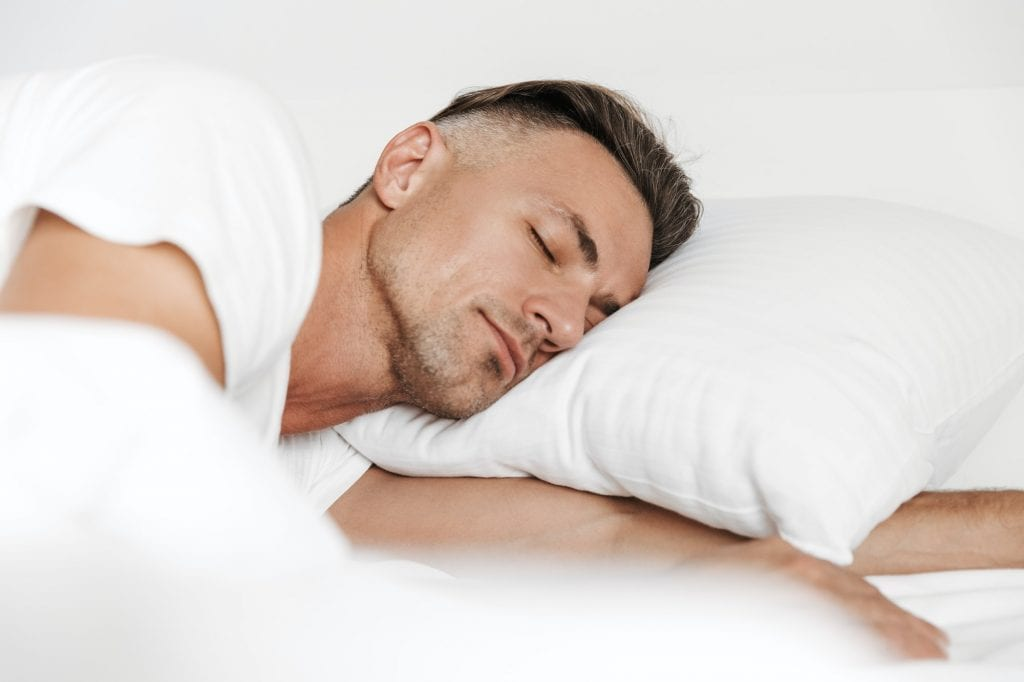 boulder dental designs sleep apnea in boulder, co Dr. John MontoyaHandsome man sleeping in bed